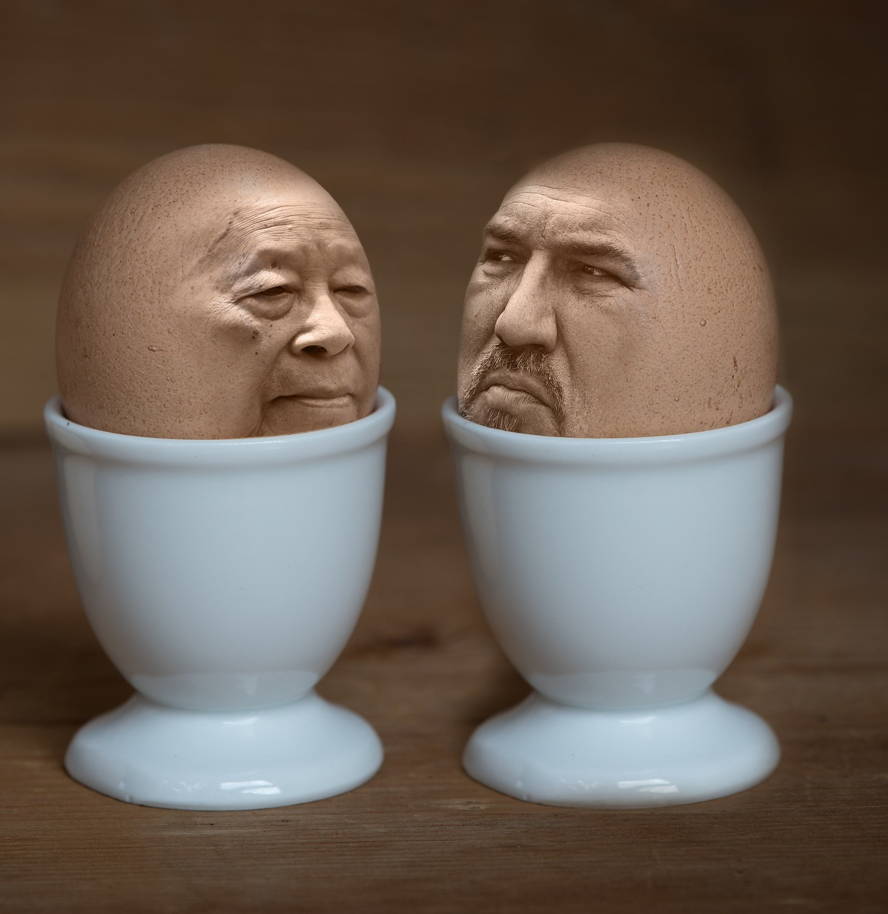 Two men in egg cups
