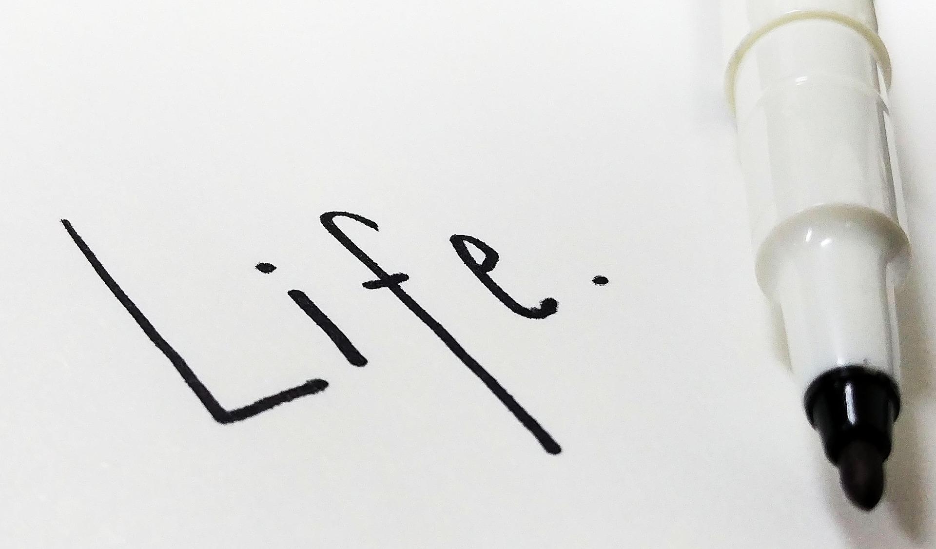life written on pad